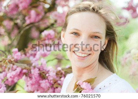 Outdoor portrait of nice young woman