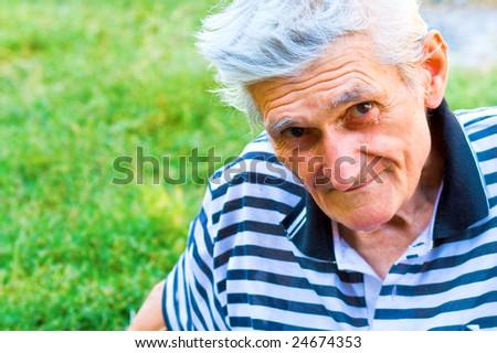 Outdoor portrait of one confident senior man
