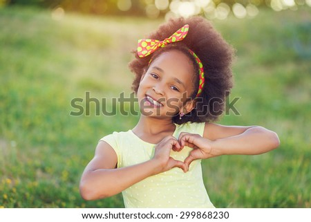 Outdoor portrait of pretty mixed race African-American girl smiling outdoor