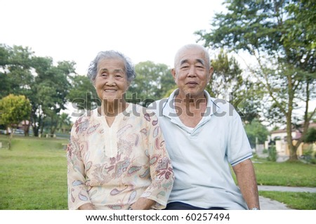 outdoor portrait of senior asian couple