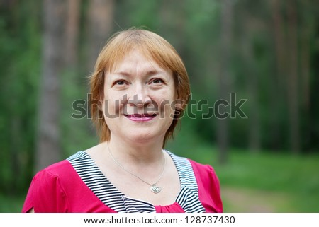 Outdoor portrait of smiling mature woman