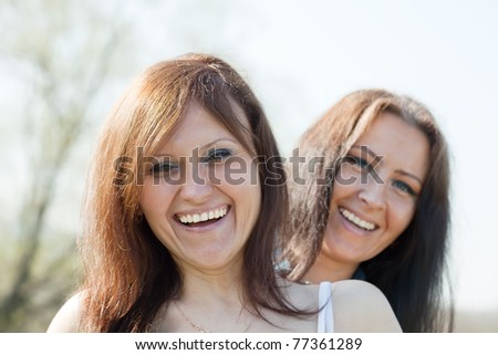Outdoor portrait of two happy women