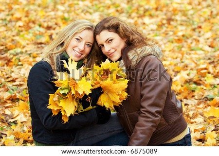 outdoor portrait of two young women in autumnal park