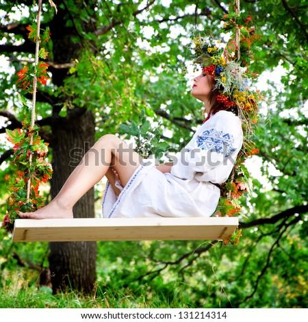 Outdoor portrait of woman in wreath