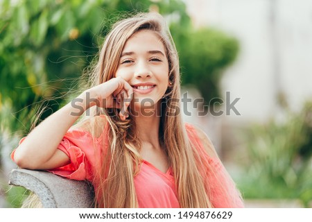 Outdoor portrait of 12 years old girl with long hair Stock photo ©