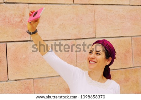 Outdoor portrait of 40 years old woman #1098658370