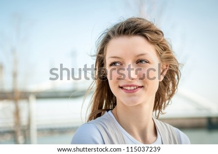 Outdoor portrait of young beautiful woman - sky in background