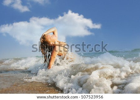 outdoor portrait of young happy woman enjoying vacations on beach