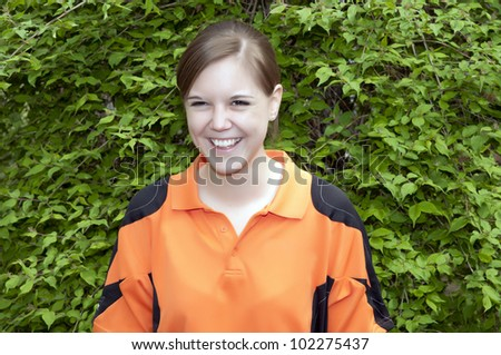 Outdoor portrait with green background