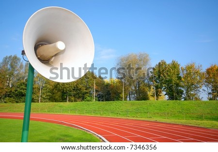Outdoor racetrack for runners. With close-up of speaker
