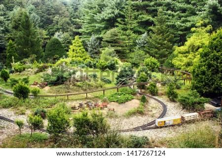 Outdoor railway diorama with trees. Train diorama on the rail track.