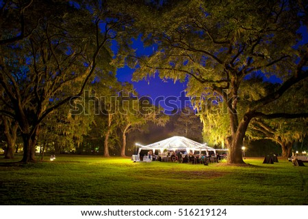 outdoor reception under tent and trees at night #516219124