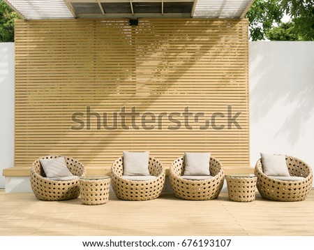 Outdoor relaxing space with trees around and rattan furniture
