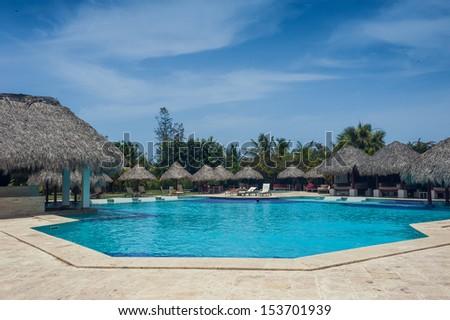 Outdoor resort pool Swimming pool of luxury hotel. Swimming pool in luxury resort near the sea. Tropical Paradise. Swimming pool in spa resort. Dominican Republic, Seychelles, Caribbean, Bahamas.