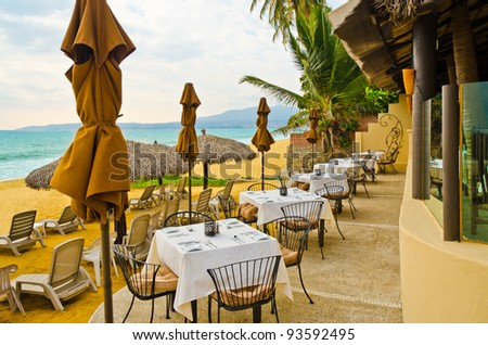 Outdoor restaurant at the beach in luxury resort in Mexico.