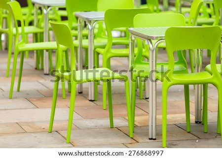 Outdoor restaurant coffee open air cafe green chairs with table. Summer vacation on resort