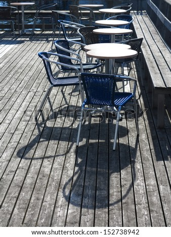 Outdoor restaurant coffee terrace open air cafe chairs with table. Summer vacation on resort