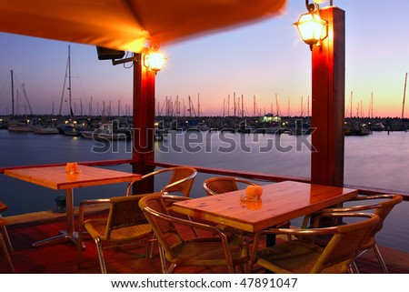 Outdoor restaurant on marina at Mediterranean sea at evening in Ashqelon, Israel.