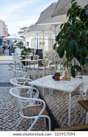Outdoor restaurant open air cafe chairs with tables in Portugal