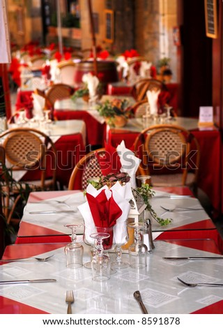 Outdoor restaurant patio on the street of Sarlat, Dordogne region, France