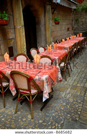 Outdoor restaurant patio on the street of Sarlat, Dordogne region, France