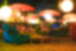 Outdoor restaurant with parasols. Blurred background