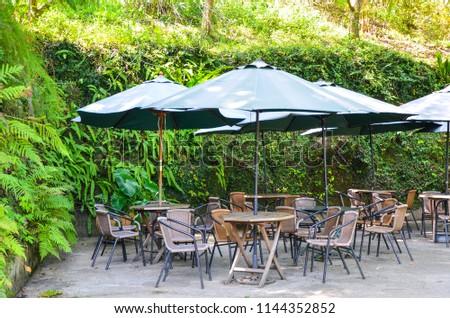 Outdoor seat parasol. #1144352852