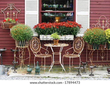 outdoor settee with autumn flowers