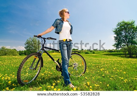 Outdoor shoot of young woman with bicycle