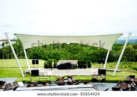 outdoor stage in front of mountain