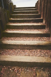 Outdoor stairs made of wood and stones.