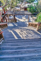 Outdoor stairway with view of wooden deck and pergola in San Diego California