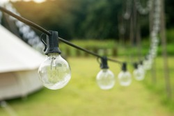 Outdoor string Light bulbs hanging on a line