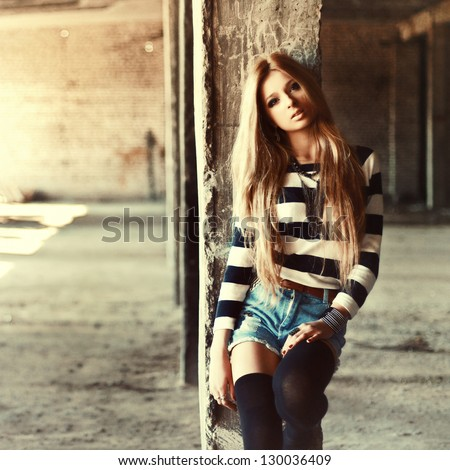 Outdoor summer portrait of young pretty cute blonde girl. Beautiful woman posing in spring.