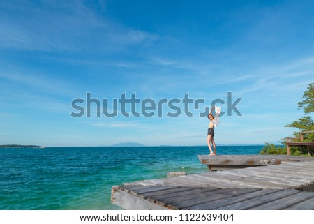 Outdoor summer portrait of young pretty woman looking to the oce