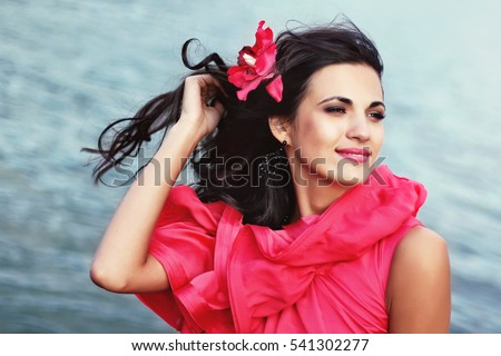 Outdoor summer style woman,sunny fashion portrait of sensual woman wear pink dress on the beach sunset on the ocean seashore.Close-up lifestyle summer outfit of beauty woman,wind hair