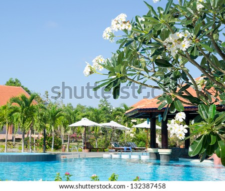 outdoor swimming pool near hotel, on sunny day - stock photo