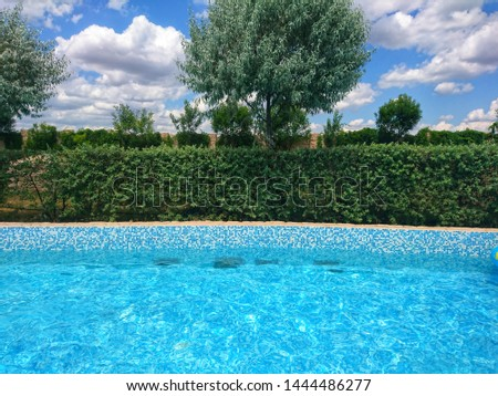 Outdoor swimming pool with clear clear blue water