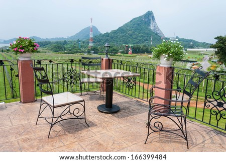 Outdoor table and chair garden furniture with nature view