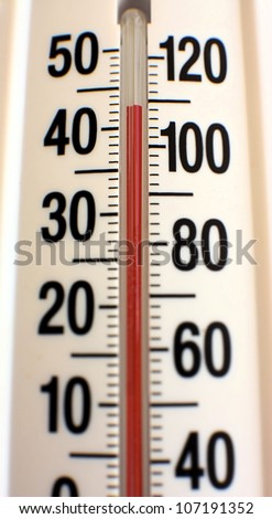 Outdoor thermometer showing unusually hot summer temperatures.