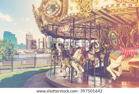Outdoor vintage flying horse carousel in the the city