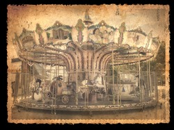 Outdoor vintage photo flying horse carousel in the the city filtered