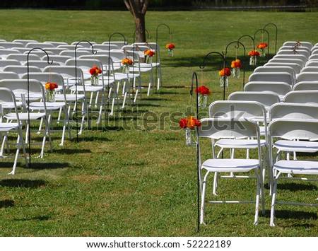 stock photo Outdoor Wedding Aisle With Flowers