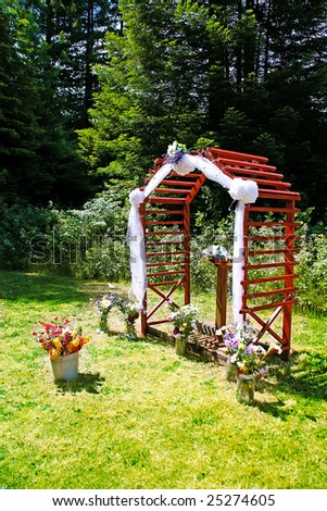 stock photo Outdoor Wedding Ceremony with Redwood Arch