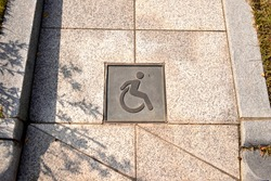 Outdoor wheelchair ramp and pictogram for handicapped