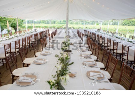 Outdoor winery banquet table placement and setup