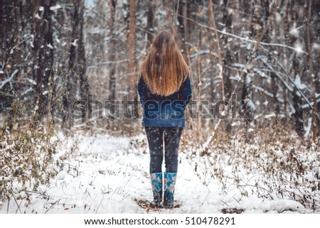 Outdoor winter forest landscape. Winter portrait photography. Winter girl standing backwards in winter forest outdoor. Woman in winter woods snow. Winter nature landscape. Winter woman watching snow #510478291