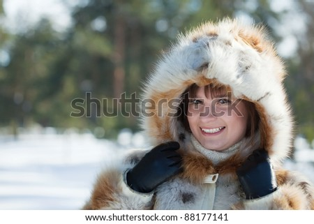 Stock Photo Outdoor winter portrait of girl in wintry clothes