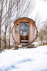 Outdoor wooden and transportable sauna in an old wine barrel