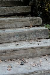 Outdoor wooden stair in nature. Wooden vintage walkway. Vertical wooden stair background.